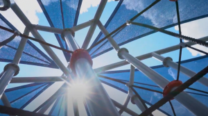 View from under a playground cover in a park